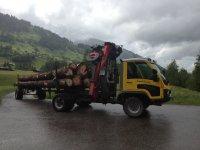 Aebi VT mit Kran beim Holztransport